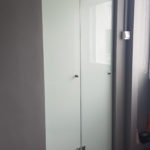 Laminated bi-fold glass door